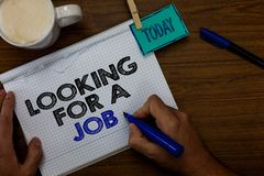 Writing note showing Looking For A Job. Business photo showcasing Unemployed seeking work Recruitment Human Resources. Hand hold pen coffee cup blue pen paper royalty free stock photography