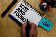 Writing note showing Lost And Found. Business photo showcasing Place where you can find forgotten things Search service Man holdin. G marker notebook clothespin stock photo