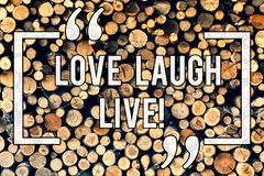 Writing note showing Love Laugh Live. Business photo showcasing Be inspired positive enjoy your days laughing good humor. Wooden background vintage wood wild royalty free stock images