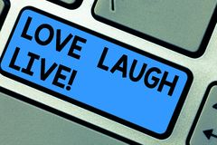 Writing note showing Love Laugh Live. Business photo showcasing Be inspired positive enjoy your days laughing good humor. Keyboard key Intention to create stock photos