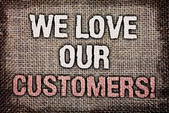 Writing note showing We Love Our Customers Call. Business photo showcasing Client deserves good service satisfaction respect Anti. Que jute background message Stock Images