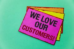 Writing note showing  We Love Our Customers Call. Business photo showcasing Client deserves good service satisfaction respect Idea. S message communicate Stock Photography