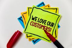 Writing note showing We Love Our Customers Call. Business photo showcasing Client deserves good service satisfaction respect Pen. Marker ideas markers message Royalty Free Stock Photography