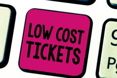 Writing note showing Low Cost Tickets. Business photo showcasing small paper bought to provide access to service or show.  royalty free stock photo