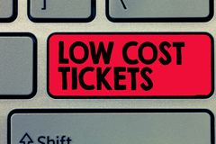 Writing note showing Low Cost Tickets. Business photo showcasing small paper bought to provide access to service or show.  royalty free stock photos