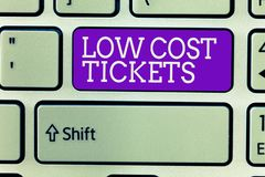Writing note showing Low Cost Tickets. Business photo showcasing small paper bought to provide access to service or show.  royalty free stock images
