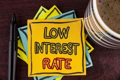 Writing note showing Low Interest Rate. Business photo showcasing Manage money wisely pay lesser rates save higher written on Sti. Writing note showing Low stock image