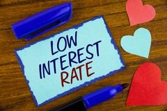 Writing note showing Low Interest Rate. Business photo showcasing Manage money wisely pay lesser rates save higher written on Sti. Writing note showing Low royalty free stock photos