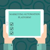 Writing note showing Marketing Automation Platform. Business photo showcasing automate repetitive task related to marketing Hu. Analysis Hand Holding Tablet stock illustration