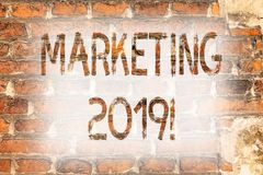 Writing note showing Marketing 2019. Business photo showcasing New Year Market Strategies Fresh start Advertising Ideas Brick Wall. Art like Graffiti royalty free stock image
