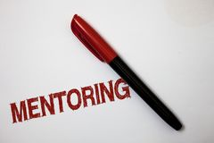 Writing note showing Mentoring. Business photo showcasing To give advice or support to a younger less experienced person Softliner. Pointer ink handwriting note royalty free stock photos