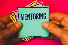 Writing note showing Mentoring. Business photo showcasing To give advice or support to a younger less experienced person Small mul. Ti colour notes hand border royalty free stock images