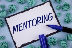Writing note showing Mentoring. Business photo showcasing To give advice or support to a younger less experienced person written. Sticky note paper within Paper stock photos