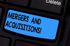 Writing note showing Mergers And Acquisitions. Business photo showcasing Refers to the consolidation of companies or. Assets Keyboard key Intention to create stock image