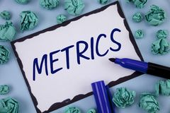 Writing note showing  Metrics. Business photo showcasing Method of measuring something Study poetic meters Set of numbers written. Sticky note paper within Stock Images