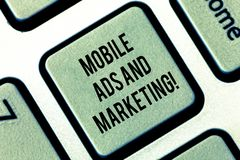 Writing note showing Mobile Ads And Marketing. Business photo showcasing Online advertising social media digital. Promotions Keyboard key Intention to create stock images