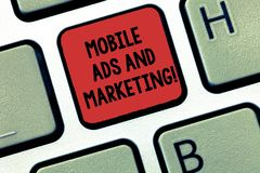 Writing note showing Mobile Ads And Marketing. Business photo showcasing Online advertising social media digital. Promotions Keyboard Intention to create royalty free stock images