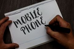 Writing note showing Mobile Phone. Business photo showcasing A handheld device used to send receive calls and messages Man hand ho. Lding marker communicating stock photo