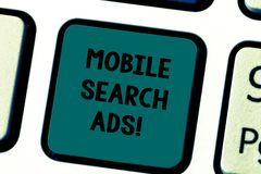 Writing note showing Mobile Search Ads. Business photo showcasing ad that can appear on webpages and apps viewed on. Phone Keyboard key Intention to create royalty free stock image
