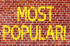 Writing note showing Most Popular. Business photo showcasing Top Rating Bestseller Favorite Product or Artist 1st in ranking Brick. Wall art like Graffiti royalty free stock photography