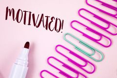 Writing note showing  Motivated Motivational Call. Business photo showcasing Willing to do something Inspired Confident written on. Writing note showing Royalty Free Stock Photos
