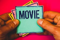 Writing note showing Movie. Business photo showcasing Cinema or television film Motion picture Video displayed on screen Small mul. Ti colour notes hand border Royalty Free Stock Images