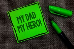 Writing note showing My Dad My Hero. Business photo showcasing Admiration for your father love feelings emotions compliment Black. Lined green sticky note with royalty free stock image