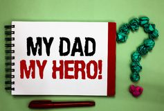 Writing note showing My Dad My Hero. Business photo showcasing Admiration for your father love feelings emotions compliment Celado. N color background red sided stock images