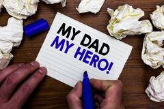 Writing note showing My Dad My Hero. Business photo showcasing Admiration for your father love feelings emotions compliment Hand h. Olding marker write words royalty free stock images