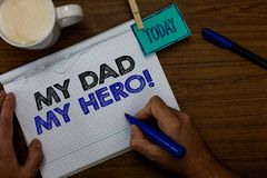 Writing note showing My Dad My Hero. Business photo showcasing Admiration for your father love feelings emotions compliment Hand h. Old pen coffee cup blue pen royalty free stock photography