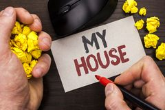 Writing note showing  My House. Business photo showcasing Housing Home Residential Property Family Household New Estate written by. Man Note Paper Holding Royalty Free Stock Photos