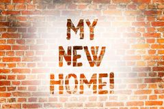 Writing note showing My New Home. Business photo showcasing Relocation moving to another house Real estate investment. Brick Wall art like Graffiti motivational royalty free stock photography