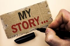 Writing note showing  My Story.... Business photo showcasing Biography Achievement Personal History Profile Portfolio written by M. An Holding Marker tear Royalty Free Stock Photo