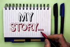Writing note showing  My Story.... Business photo showcasing Biography Achievement Personal History Profile Portfolio written by M. An Holding Marker Nootbook Royalty Free Stock Images