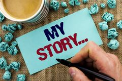 Writing note showing  My Story.... Business photo showcasing Biography Achievement Personal History Profile Portfolio written by M. An Holding Pen Sticky Note Royalty Free Stock Photo
