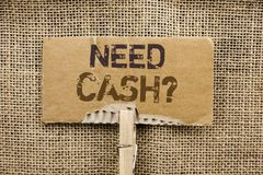 Writing note showing  Need Cash Question. Business photo showcasing Wealth Question Needy Currency Money Advice Conceptual written. Cardboard Piece Holding By Royalty Free Stock Photography