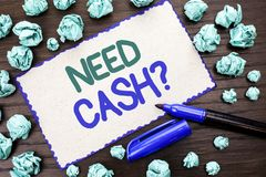 Writing note showing  Need Cash Question. Business photo showcasing Wealth Question Needy Currency Money Advice Conceptual written. Cardboard Piece the wooden Royalty Free Stock Image