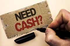 Writing note showing  Need Cash Question. Business photo showcasing Wealth Question Needy Currency Money Advice Conceptual written. By Man Holding Marker tear Stock Photography