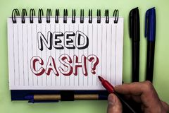 Writing note showing  Need Cash Question. Business photo showcasing Wealth Question Needy Currency Money Advice Conceptual written. By Man Holding Marker Stock Photo