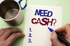 Writing note showing  Need Cash Question. Business photo showcasing Wealth Question Needy Currency Money Advice Conceptual written. By Man Notebook Paper Royalty Free Stock Photo