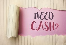 Writing note showing  Need Cash Question. Business photo showcasing Wealth Question Needy Currency Money Advice Conceptual written. The pink background behind Royalty Free Stock Image