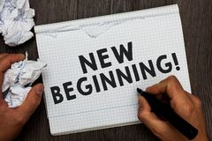 Writing note showing New Beginning. Business photo showcasing Different Career or endeavor Starting again Startup Renew Man holdin. G marker notebook crumpled stock image