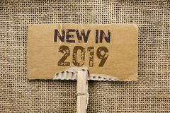 Writing note showing New In 2019. Business photo showcasing Fresh Era Latest Year Period Season Annual Coming Modern written on C. Writing note showing New In royalty free stock photography