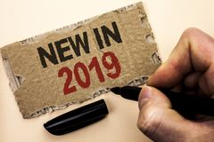 Writing note showing New In 2019. Business photo showcasing Fresh Era Latest Year Period Season Annual Coming Modern written by M. An Holding Marker tear stock image