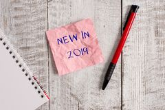 Writing note showing New In 2019. Business photo showcasing what will be expecting or new creation for the year 2019. Writing note showing New In 2019. Business stock photography