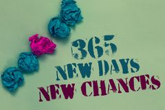Writing note showing 365 New Days New Chances. Business photo showcasing Starting another year Calendar Opportunities Drawn blue a. Nd red words teal color paper royalty free stock photography