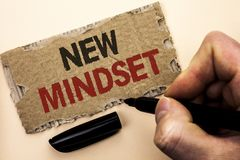 Writing note showing  New Mindset. Business photo showcasing Attitude Latest Concept Vision Behaviour Plan Thinking written by Man. Holding Marker tear Stock Image