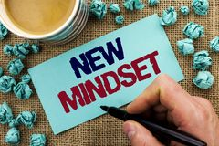 Writing note showing  New Mindset. Business photo showcasing Attitude Latest Concept Vision Behaviour Plan Thinking written by Man. Holding Pen Sticky Note Stock Image