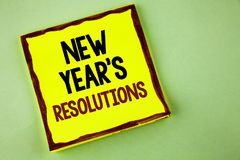 Writing note showing  New Year\'S Resolutions. Business photo showcasing Goals Objectives Targets Decisions for next 365 days writ. Ten Yellow Sticky note paper Royalty Free Stock Photo