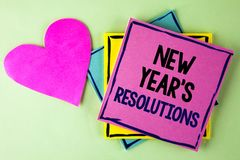 Writing note showing  New Year'S Resolutions. Business photo showcasing Goals Objectives Targets Decisions for next 365 days writ. Ten Pink Sticky Note Paper Stock Images